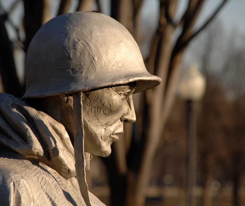 Profile of a statue of a soldier from a memorial in D.C.